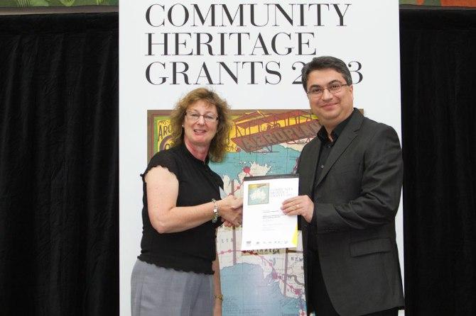 UoN Conservator Amir Mogadam receiving Certificate from National Library representative.