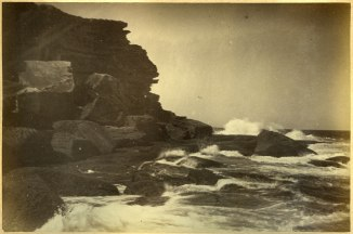 Closeup of Newcastle coastline with clashing waves. (Photograph by George Freeman)