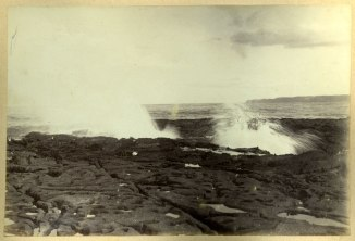 Closeup of ocean rock platform and crashing waves (Photograph by George Freeman)