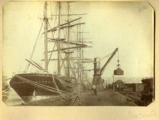 The Pilgrim Boston coal loading in Newcastle Harbour circa 1880s (Photograph by George Freeman)