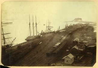 Coaling ships at Newcastle Wharf, Nobbys in distance circa 1880s (Photograph by George Freeman)