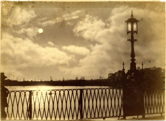Street lamp on bridge over unidentified river. (Photograph by George Freeman)