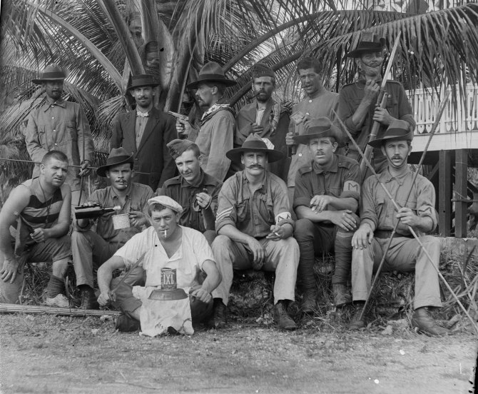 Troops posing for a comical photograph after fall of German Papua,1914 (Thomas James Rodoni)
