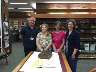 Sanders Family Bible donated to Cultural Collection in the Auchmuty Library UON, l-r Gionni Di Gravio, University Archivist; Lyn Keily, Special Collections Librarian, with great great grand daughters of Nicholas and Isabell Sanders, Joy-Elaine Lewis and Helen Lewis