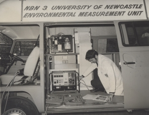 A Phillips' technician completing installation of the SO2 monitor in a Kombi van at the University of Newcastle, Australia