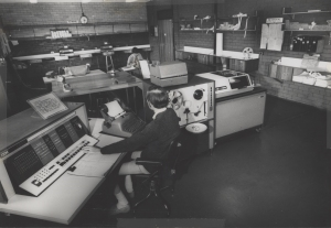 Two gentlemen using IBM1620 data processing system, the University of Newcastle, Australia