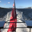 Red Ensign at rear of MONA vessel